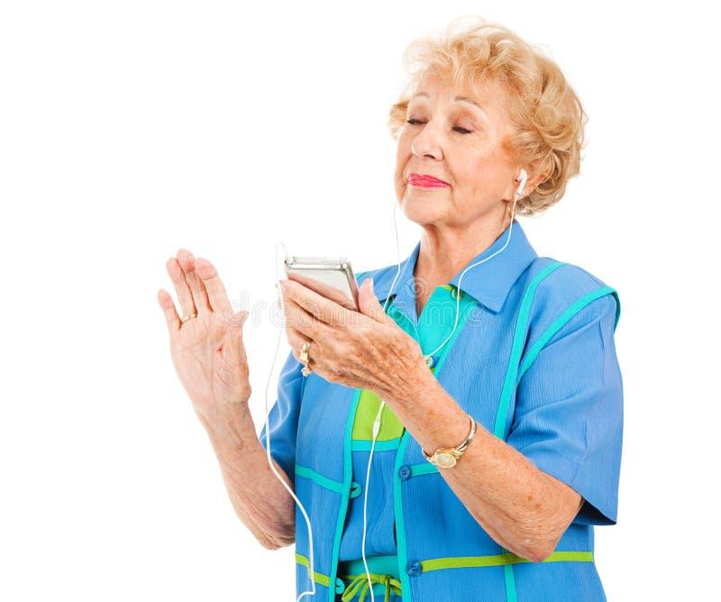 Senior Lady Listens to Music stock photo