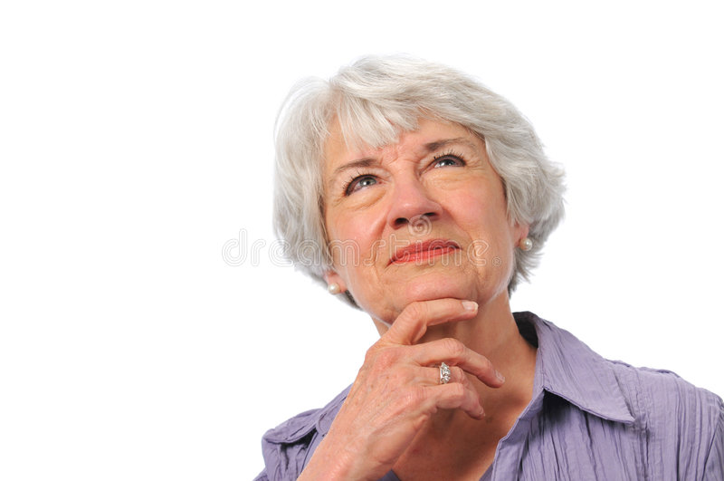 Senior lady looking up and thinking royalty free stock photos