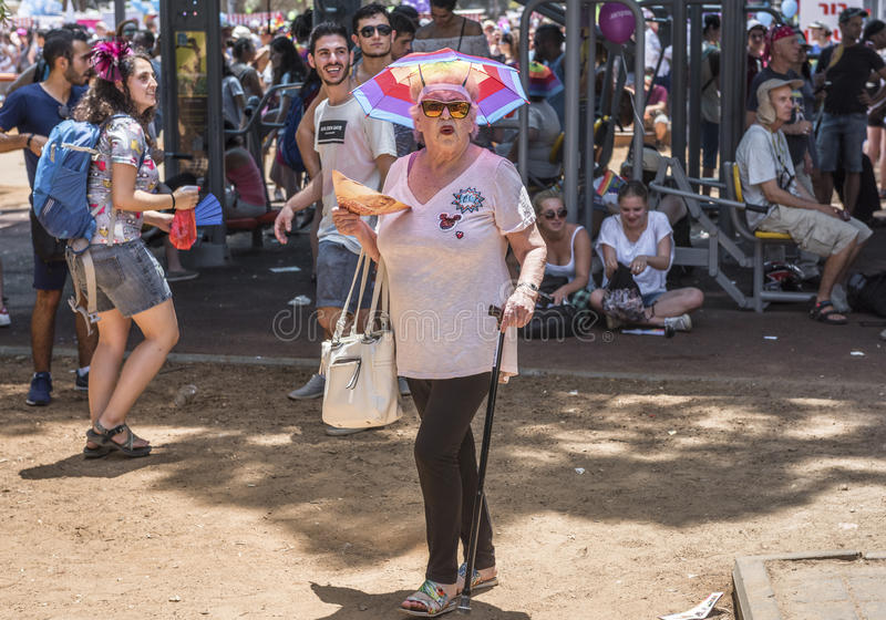 Senior lady participant at Gay Pride Parade royalty free stock photo