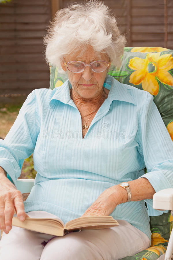Download Senior Lady Reading In The Garden Stock Images - Image: 15338494