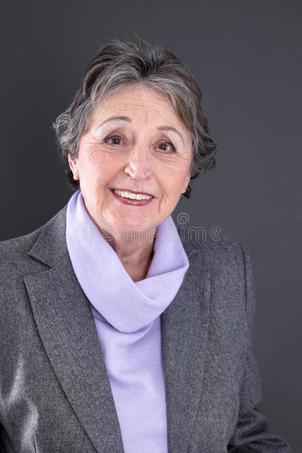 Senior lady satisfied - elder woman isolated on black background royalty free stock photos