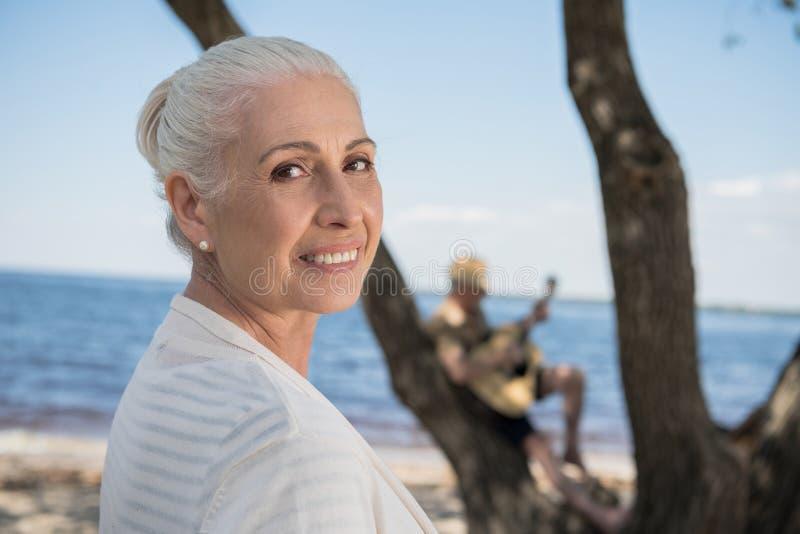 Senior lady smiling and looking at camera outdoors. Beautiful senior lady smiling and looking at camera outdoors stock photos