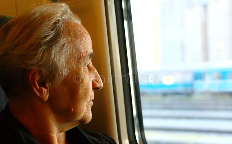 Senior Lady Travelling With Train stock images