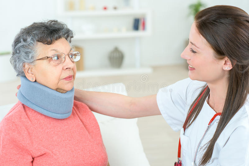 Senior lady wearing neck brace stock photo