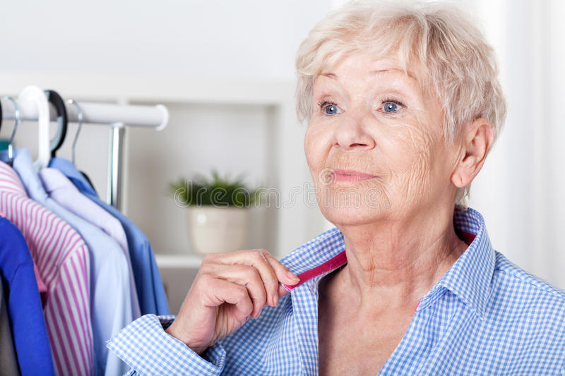 Senior lady wearing shirt stock photo