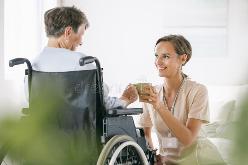 Senior lady on a wheelchair royalty free stock photography