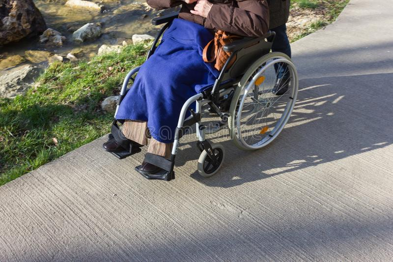 senior lady with wheelchair royalty free stock image