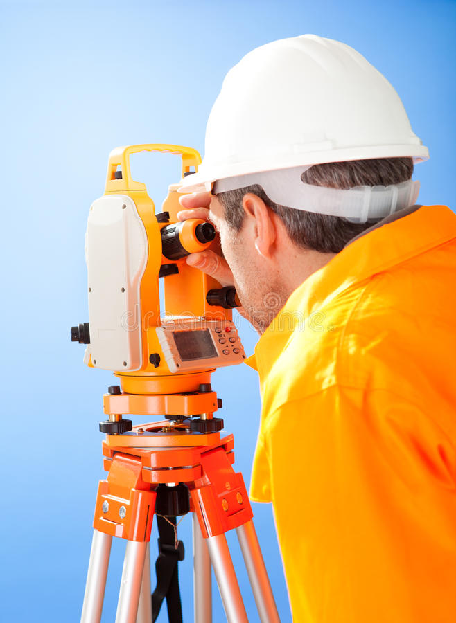 Senior land surveyor with theodolite stock images