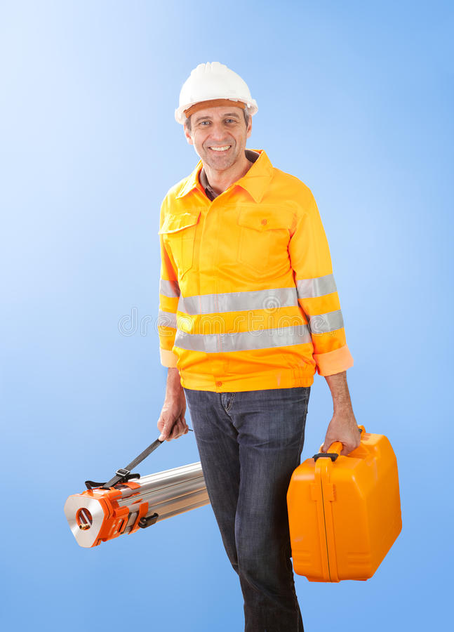 Senior land surveyor with theodolite equipment royalty free stock image