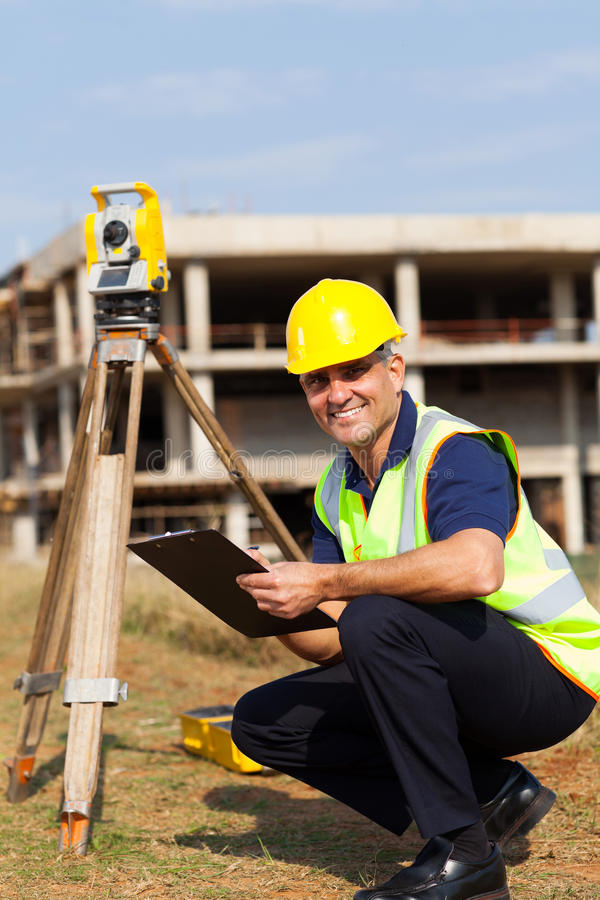 Senior land surveyor stock images