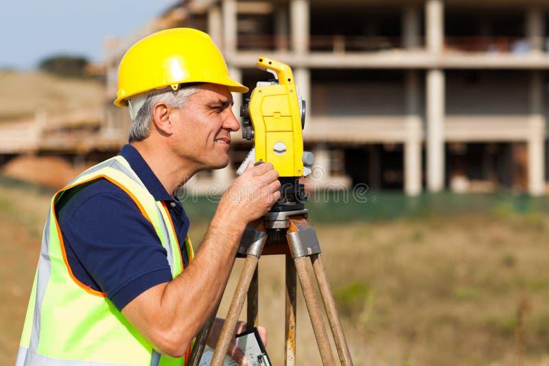 Senior land surveyor stock photography