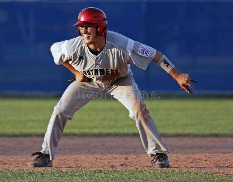 Senior league baseball world series lead. Seth Gibson of US Southwest (Tyler, Texas) leads off second base at the Senior League Baseball World Series August 18 stock photos