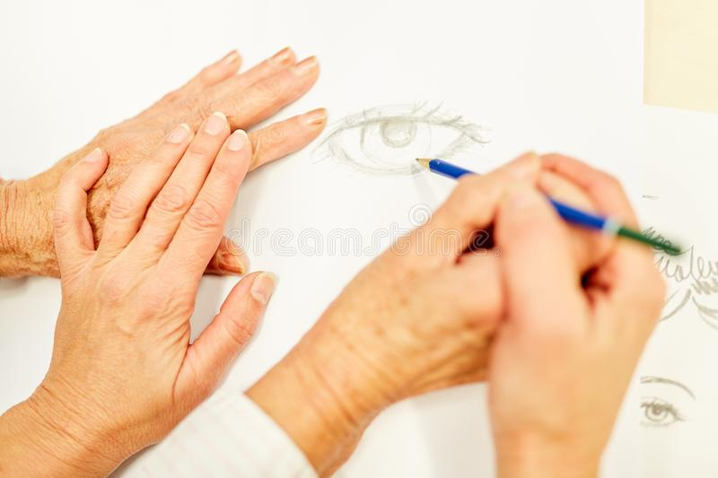 Senior makes a drawing in painting therapy royalty free stock photos