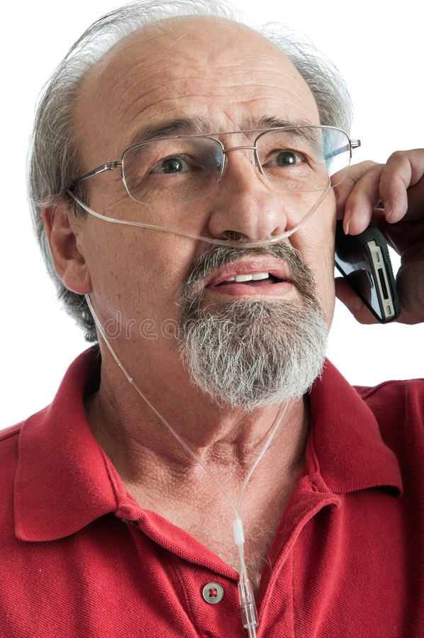 Senior male with breathing disability talking on the phone stock photos