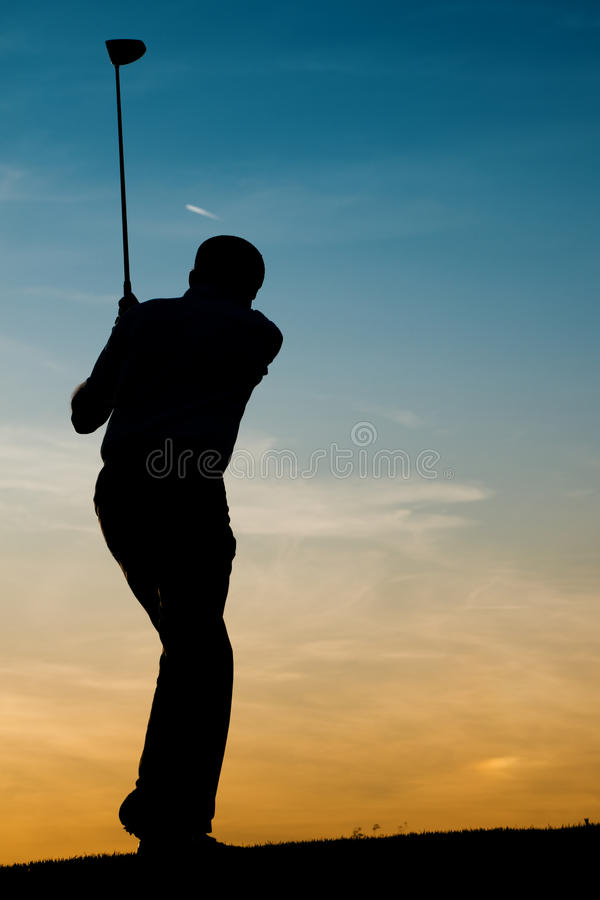 Senior male golf player at sunset royalty free stock photo
