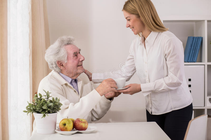 Senior male having support. Picture of senior ill male having support of his family royalty free stock images