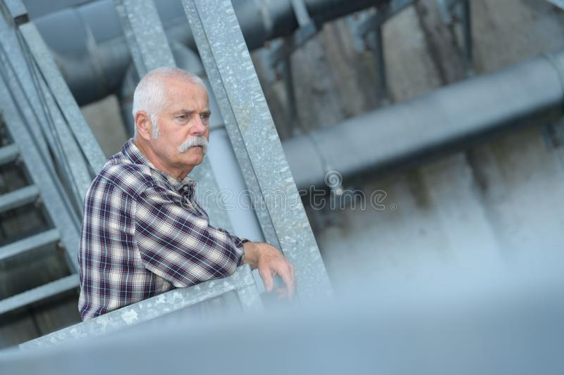 Senior male industrial engineer in industrial plant royalty free stock photo