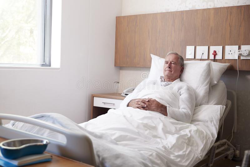 Senior Male Patient In Hospital Bed In Geriatric Unit stock image