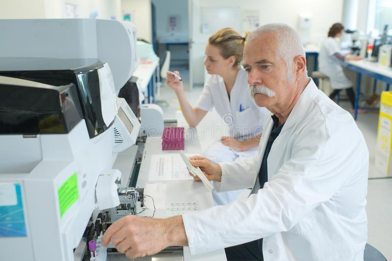 Senior male researcher carrying out scientific research in lab royalty free stock photos
