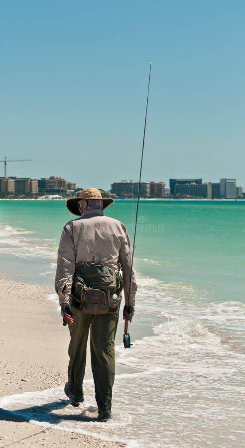 Senior, male surf fisherman walking stock photos
