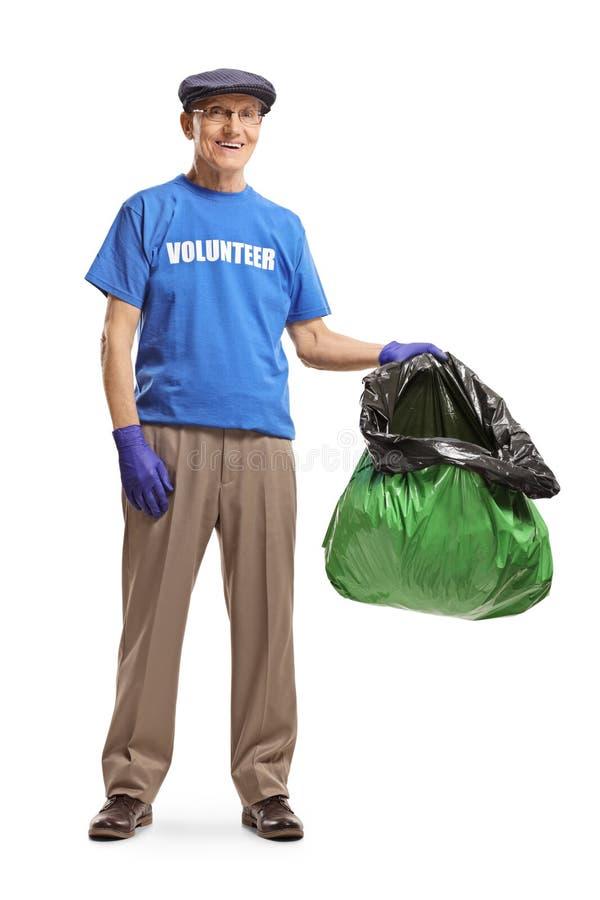 Senior male volunteer holding a plastic litter bag stock photos