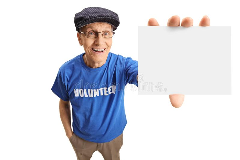 Senior male volunteer showing a blank empty card. Isolated on white background royalty free stock photo