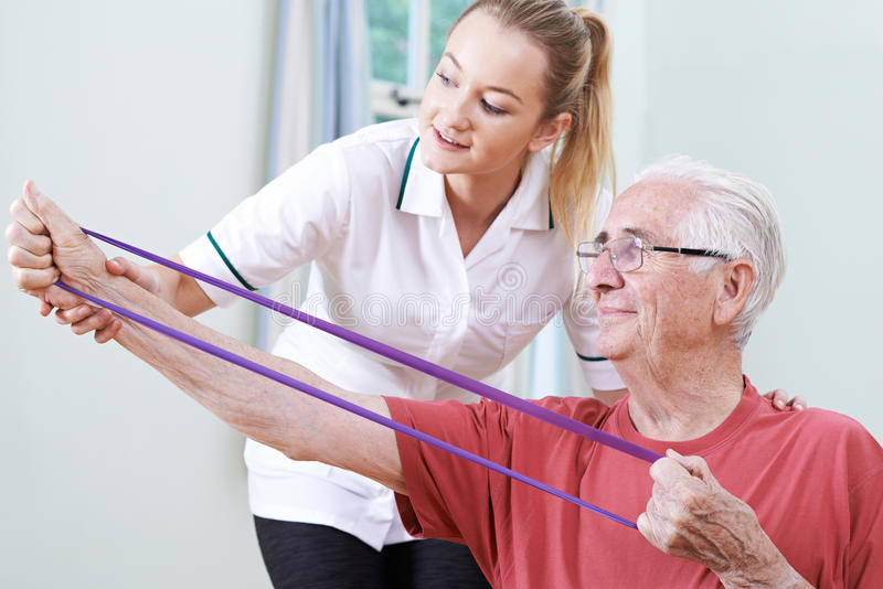 Senior Male Working With Physiotherapist royalty free stock photos