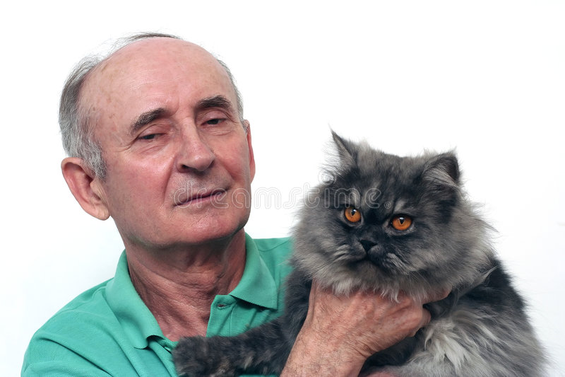 Senior man. Holding his cat stock image