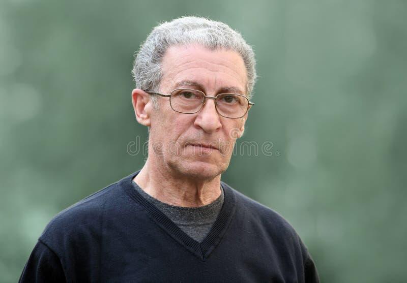 Senior man. A portrait of a serious senior man royalty free stock image