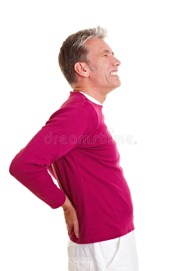 Senior man with back pain. Holding his aching back royalty free stock photos