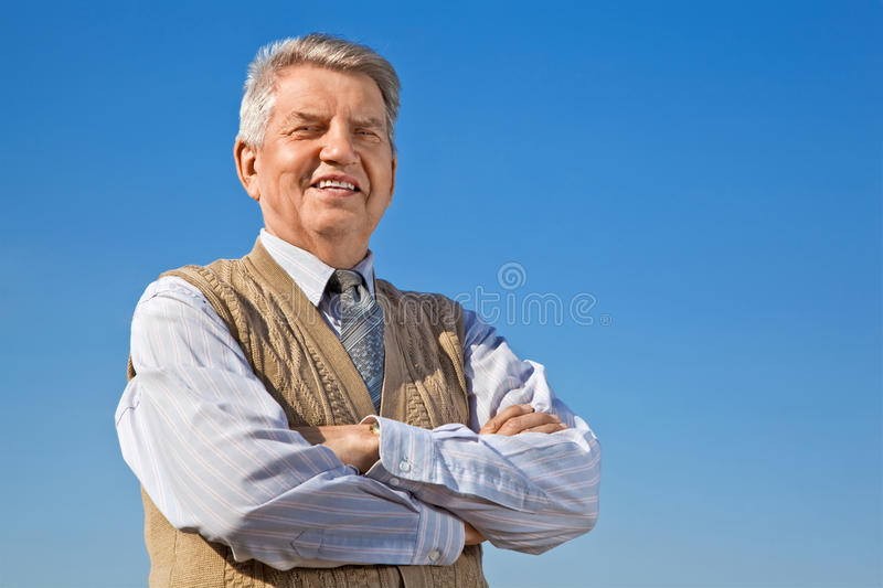 Senior man on background sky stock photography