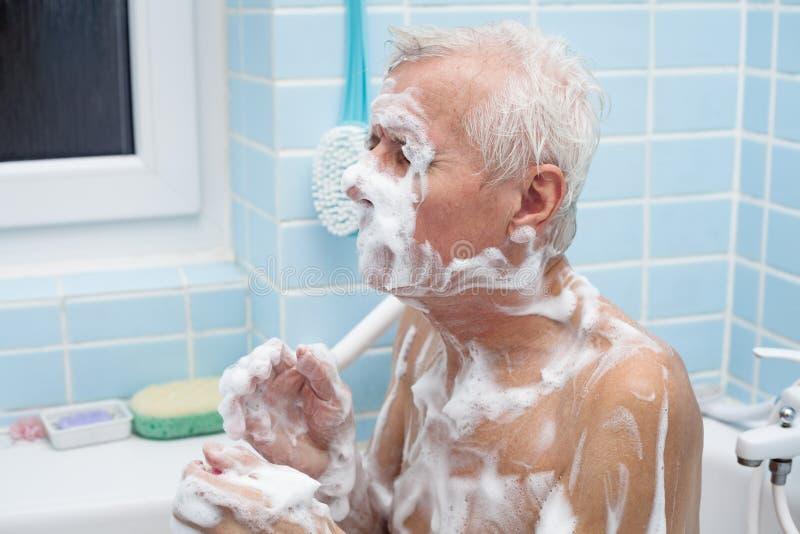 Senior man bathing royalty free stock photography