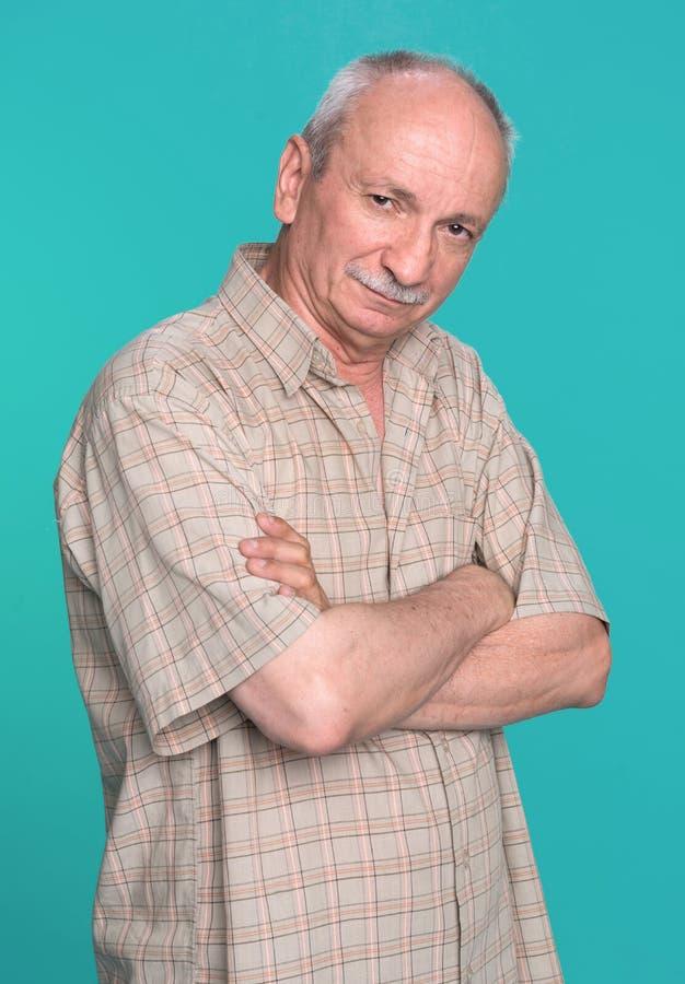 Senior Man On A Blue Background Stock Photo