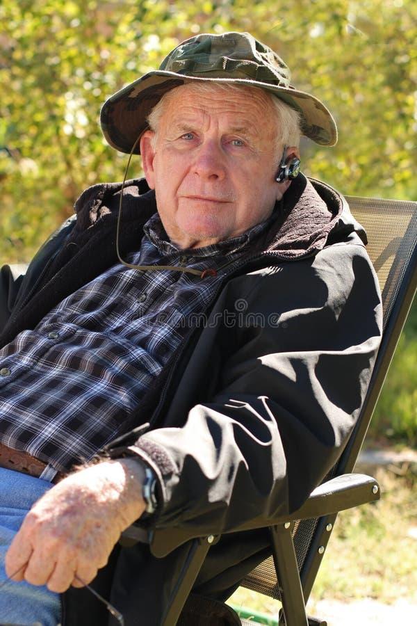 Senior man with bluetooth royalty free stock image