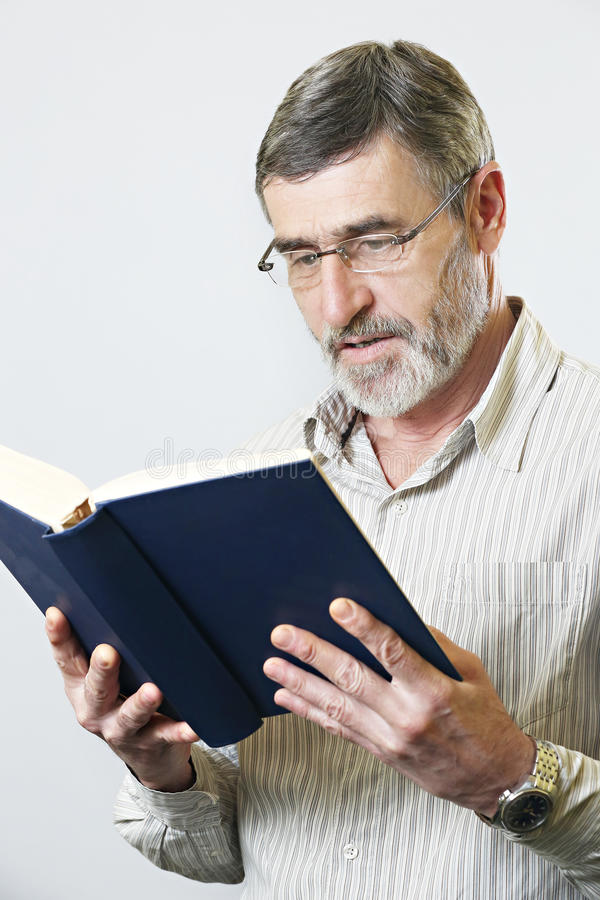 Senior man with book royalty free stock photography
