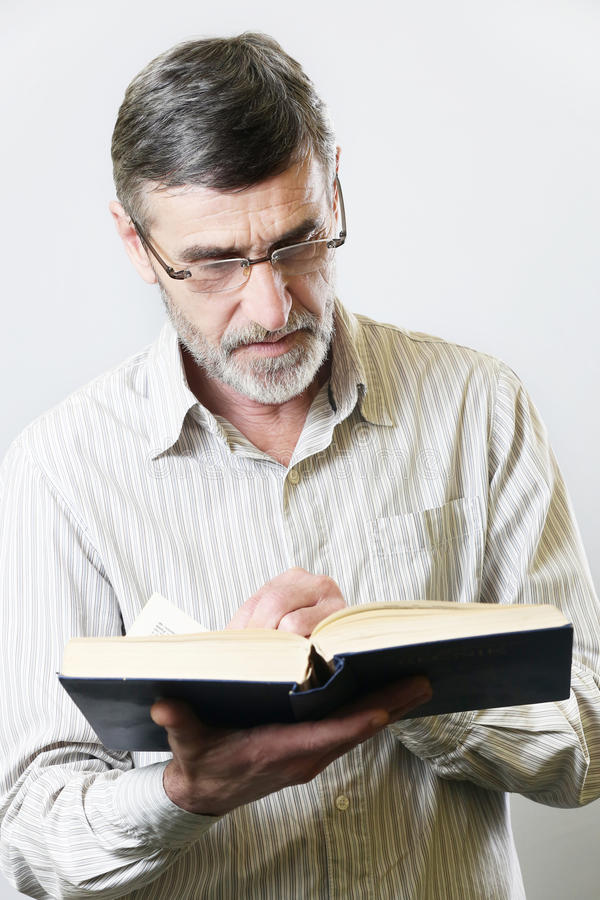 Senior man with book stock images