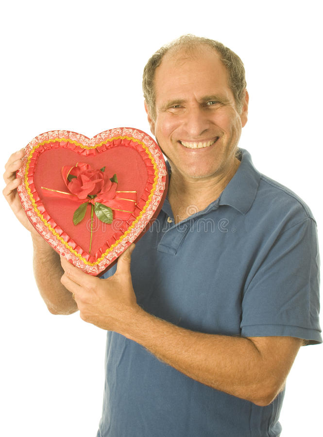 Senior man box of Valentine day chocolate candy royalty free stock image