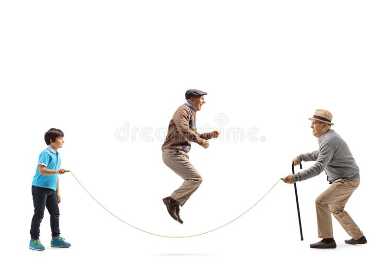Senior man and a boy holding a rope and an elderly man skipping stock images