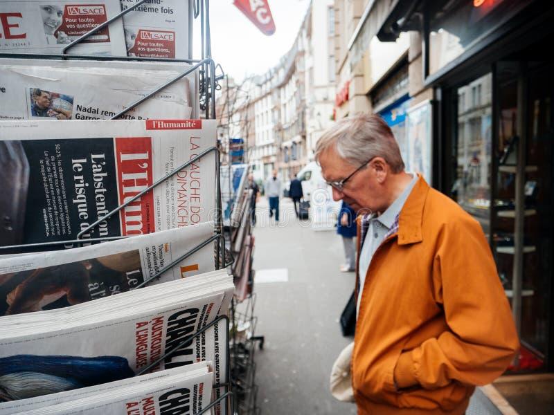 Senior man buy french press reactions to French legislative ele stock photography