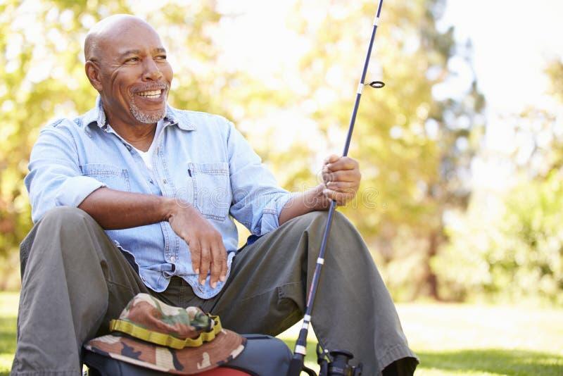 Senior Man On Camping Holiday With Fishing Rod stock image
