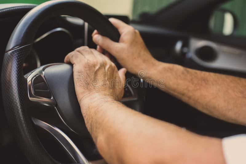 Senior man in car. Senior man driving car. Close up royalty free stock photography