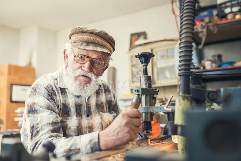 Senior man carving royalty free stock photography