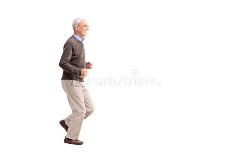 Senior man in casual clothes running and smiling royalty free stock images