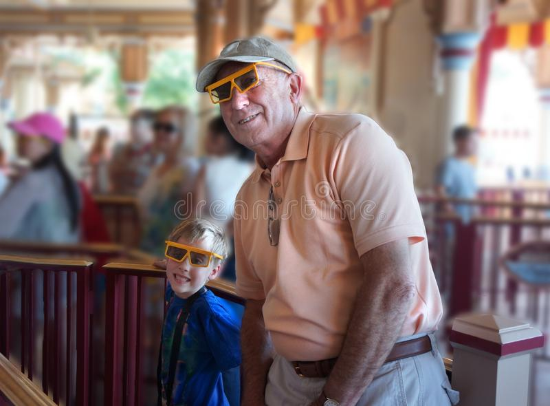 Senior Man and Child in 3 D Glasses royalty free stock image