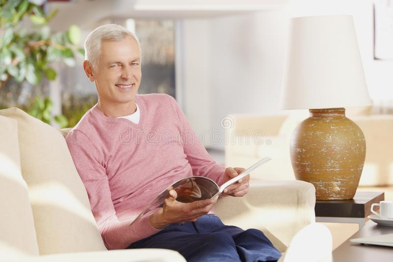 Senior man chilling at home royalty free stock images