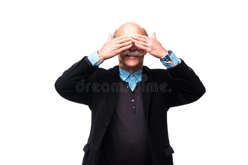 Senior man closed both his eyes with hands isolated on white background stock images