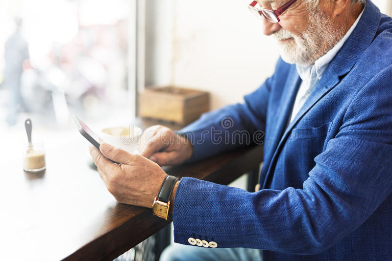 Senior Man Coffee Shop Communication Connection Technology Concept royalty free stock images