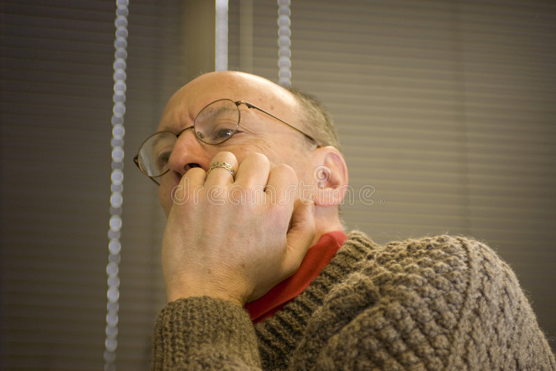 Senior man concentrating stock images