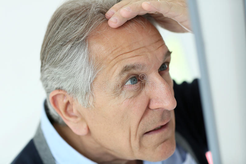 Download Senior Man Concerned About Hair Loss Stock Image - Image of hairloss, pensioner: 64951817