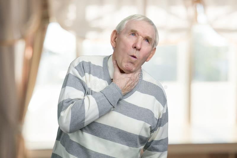 Senior man is coughing. royalty free stock photos